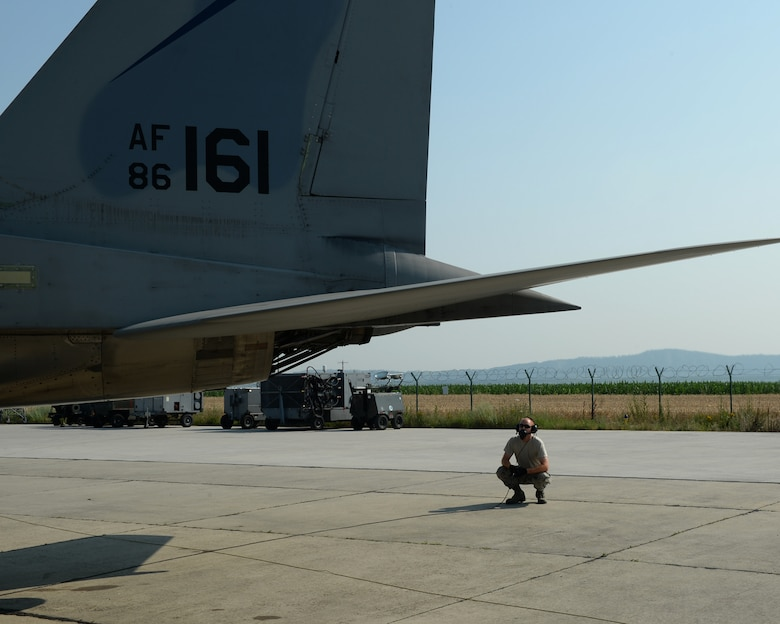 A U.S. Air National Guard crew chief from the 123rd Expeditionary Fighter Squadron performs pre-flight checks on a U.S. ANG F-15C Eagle fighter aircraft during a theater security package deployment July 7, 2015, at Campia Turzii, Romania. The U.S. Air Force's forward presence in Europe allows cooperation among NATO allies and partners to develop and improve ready air forces capable of maintaining regional security. (U.S. Air Force photo by Senior Airman Dylan Nuckolls/Released)