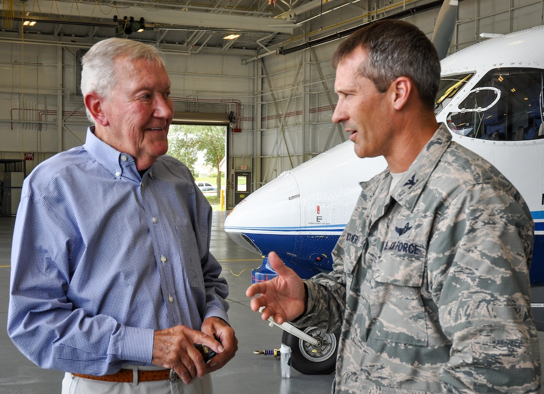 Col. Robert Bruckner, the 919th Special Operations Wing vice commander, talks with retired Brig. Gen. Don Haugen at Duke Field, Fla. July 7.  Haugen, the wing's first commander in 1971, was one of several past Duke Field commanders invited to tour the base and receive briefings on the unit's evolving special operations mission. (U.S. Air Force photo/Dan Neely)