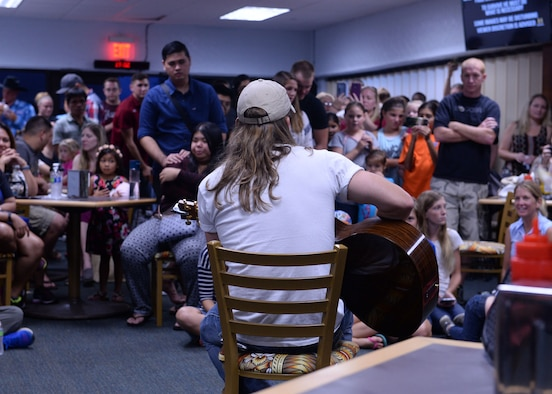 Jason Michael Carroll, country music artist, performs songs July 10, 2015, at Andersen Air Force Base, Guam. The free event provided service members and families an opportunity to break from their daily routine to enjoy music from popular recording artists. (U.S. Air Force photo by Airman 1st Class Joshua Smoot/Released)