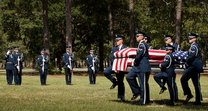 Members of the Eglin Air Force Base Honor Guard carry a casket during the unit's recent graduation ceremony. Approximately 12 new Airmen graduated from the 80-plus-hour course. The graduation performance includes flag detail, rifle volley, pall bearers and bugler for friends, family and unit commanders. The Eglin Honor Guard provides their services to the base, Duke Field and more than 20 area counties making up approximately 20,000 square miles in the Florida and Alabama region.  (U.S. Air Force photo/Tech. Sgt. Sam King)