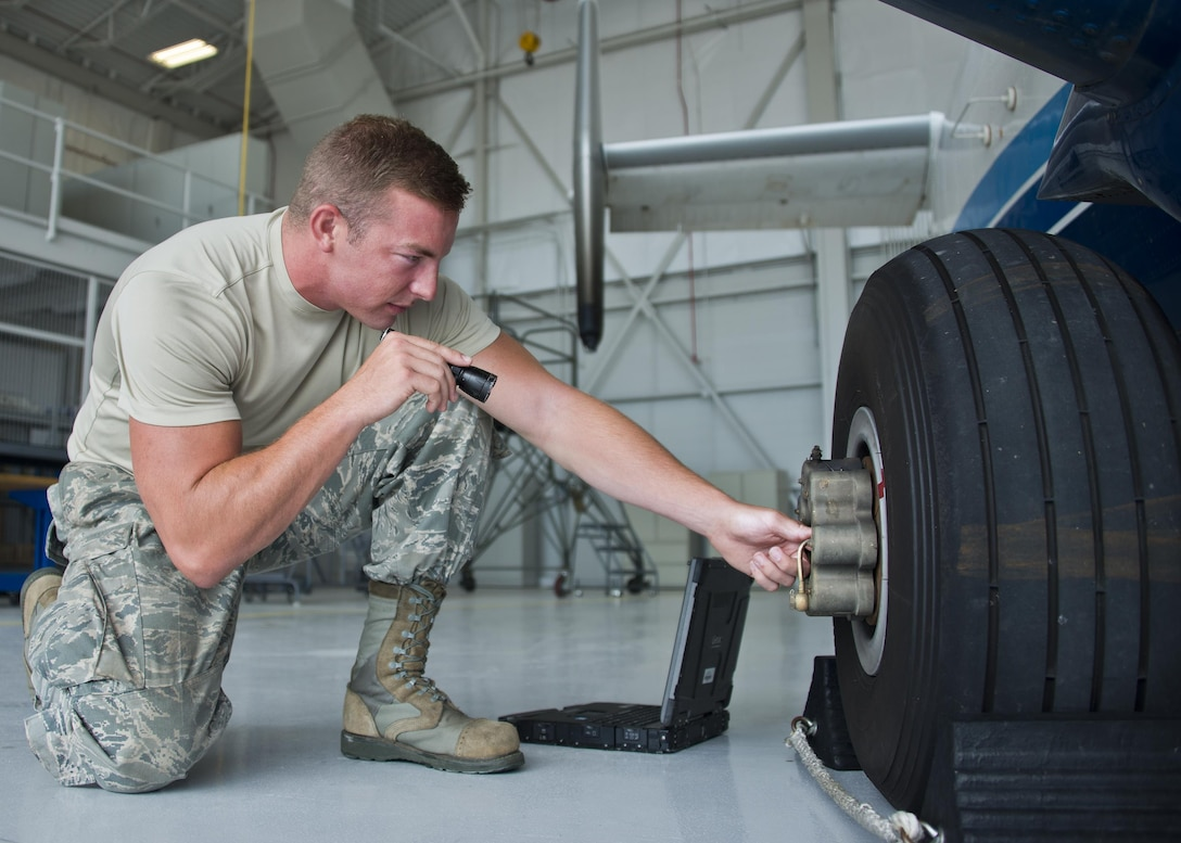 Senior Airman Kristopher Golden, 919th Special Operations Maintenance Group, checks the brakes of a C-145 June 6 at Duke Field, Fla. The 919th SOMXG is comprised of 919th SOMXS, 919th SOAMXS, 919th SOMOF, and the 592nd SOMXS. Their primary mission is the maintenance of the C-145 aircraft. (U.S. Air Force photo/Tech. Sgt. Sam King)