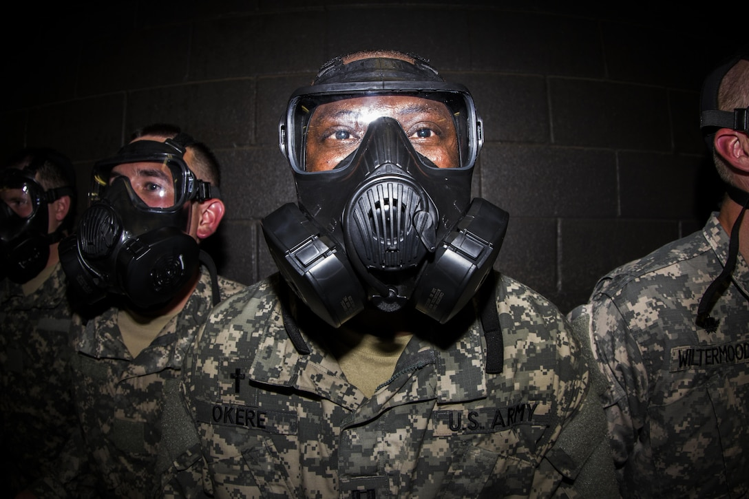 Officers in the Chaplain's Basic Officer Leaders Course put their faith in their protective gear to the test in the CBRN chamber. The 104th Training Division (LT) facilitated the training at the facility. (U.S. Army photo by Sgt. 1st Class Brian Hamilton)