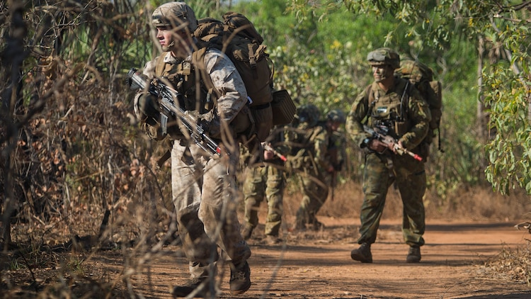 U.S. Marines, assigned to Battalion Landing Team, 2nd Battalion, 5th Marines, along with Australian Army Soldiers, assigned to 2nd Battalion, Royal Australian Regiment, move toward an objective during an amphibious assault for Talisman Sabre 2015 at Fog Bay, Australia, July 11, 2015. Talisman Sabre is a biennial exercise that provides an invaluable opportunity for nearly 30,000 U.S. and Australian defense forces to conduct operations in a combined, joint and interagency environment that will increase both countries' ability to plan and execute a full range of operations from combat missions to humanitarian assistance efforts.