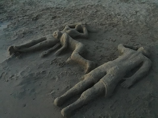 This sand family was discovered during a beach patrol by summer ranger, Ethan Speicher, at Big Hill Lake in Cherryvale, Kansas, July 11. The works were created by Jereme Glenn, with the help of his family earlier that day.