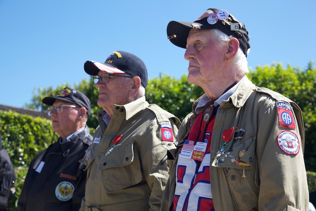 A group of World War II veterans stand with new medals given to them from the French army during a ceremony honoring paratroopers of the 82nd Airborne Division that lost their lives during World War II near Iron Mike Drop Zone near the village of Sainte Mere Eglise, Normandy, France, June 7, 2015. Over 380 service members from Europe and affiliated D-Day historical units are participating in the 71st anniversary as part of Joint Task Force D-Day 71. The task force, based in Sainte Mere Eglise, France, is supporting local events across Normandy, from June 2-8 , 2015 to commemorate the selfless actions by all the allies on D-Day that continue to resonate 71 years later. (U.S. Army photo by Sgt. Austin Berner/Released)