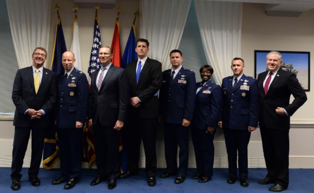 The AEHF Team receives the 2014 DoD Packard Award at a ceremony at the Pentagon, May 21.  Pictured from left to right are: Secretary of Defense Ashton Carter, Col. Stephen Purdy, Col. (ret) Rodney Miller, William Althoff, Maj. Darrell Grob, Maj. Alicia Abrams, Col. (sel) Shawn McCamish and Undersecretary of Defense (AT&L)  Frank Kendall.