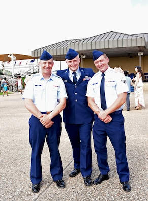 From left to right, Logan, Kendrick and Collin Schmidt pose for a photograph after a graduation ceremony at Joint Base San Antonio, Texas, June 26. Logan was the most recent graduate of Air Force basic training and the final Schmidt brother to join the Air Force. (Courtesy photo Airman 1st Class Collin Schmidt)