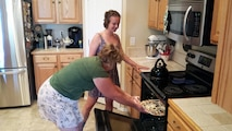 Cadet sponsor and retired master sergeant, Tracey Lundy, cooks dinner for Cadet 3rd Class Jenna Gustafson July 10, 2015. Sponsor families give cadets the opportunity to enjoy home cooked meals, as well as a place to unwind. (U.S. Air Force photo by Harry Lundy)