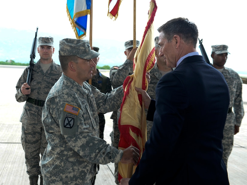 Col. Dan Barzyk, Army Support Activity incoming commander, receives the guidon from Mr. Thomas Schoenbeck, U.S. Army Installation Management Command regional director, during the Army Support Activity change of command July 9, 2015, at Soto Cano Air Base, Honduras. The change of command signified the passing of responsibilities from the previous commander, Col. Rollin Miller, to Barzyk. (U.S. Air Force photo by Staff Sgt. Jessica Condit)