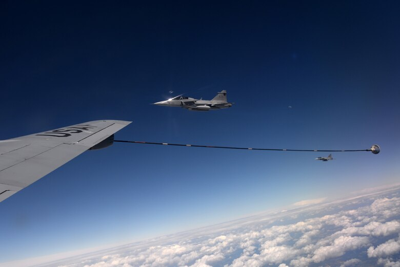 Swedish and Hungarian air force JAS-39 Gripens fly next to a U.S. Air Force KC-135 Stratotanker June 25, 2015, during air refueling familiarization training over Hungary. Hungarian, U.S. and Swedish air force personnel met for a two-week familiarization period enabling the Hungarian JAS-39 Gripen pilots to successfully perform air refueling for the first time. (U.S. Air Force photo by Senior Airman Kate Thornton/Released)