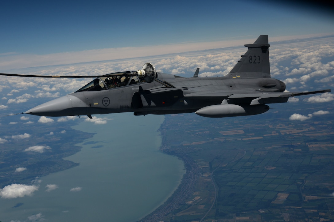 A Swedish air force JAS-39 Gripen makes contact with a multi-point refueling system basket June 25, 2015, during air refueling familiarization training over Hungary. Hungarian, U.S. and Swedish air force personnel met for a two-week familiarization period enabling the Hungarian JAS-39 Gripen pilots to successfully perform air refueling for the first time. (U.S. Air Force photo by Senior Airman Kate Thornton/Released)