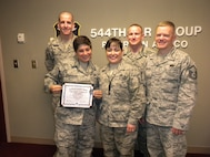 PETERSON AIR FORCE BASE, Colorado – The Peterson Diamond Sharp Council awarded its Diamond Sharp Award June 11 to Tech. Sgt. Jamie Grabowski, 544th Intelligence Surveillance and Reconnaissance Group Cyber Surety NCOIC. Grabowski was instrumental in designing and assembling an inspector general planning room, delivering an impeccable workspace with ample communications capabilities. Additionally, she was entrusted to complete the unit's modernization effort from legacy BlackBerry handheld devices to iPhones, ensuring a seamless transition while saving more than $3,000. She also completely revamped the group-wide configuration management program overseeing more than 100 weapon system components ensuring operational capability of a $1.5 billion enterprise. (U.S. Air Force photo)
