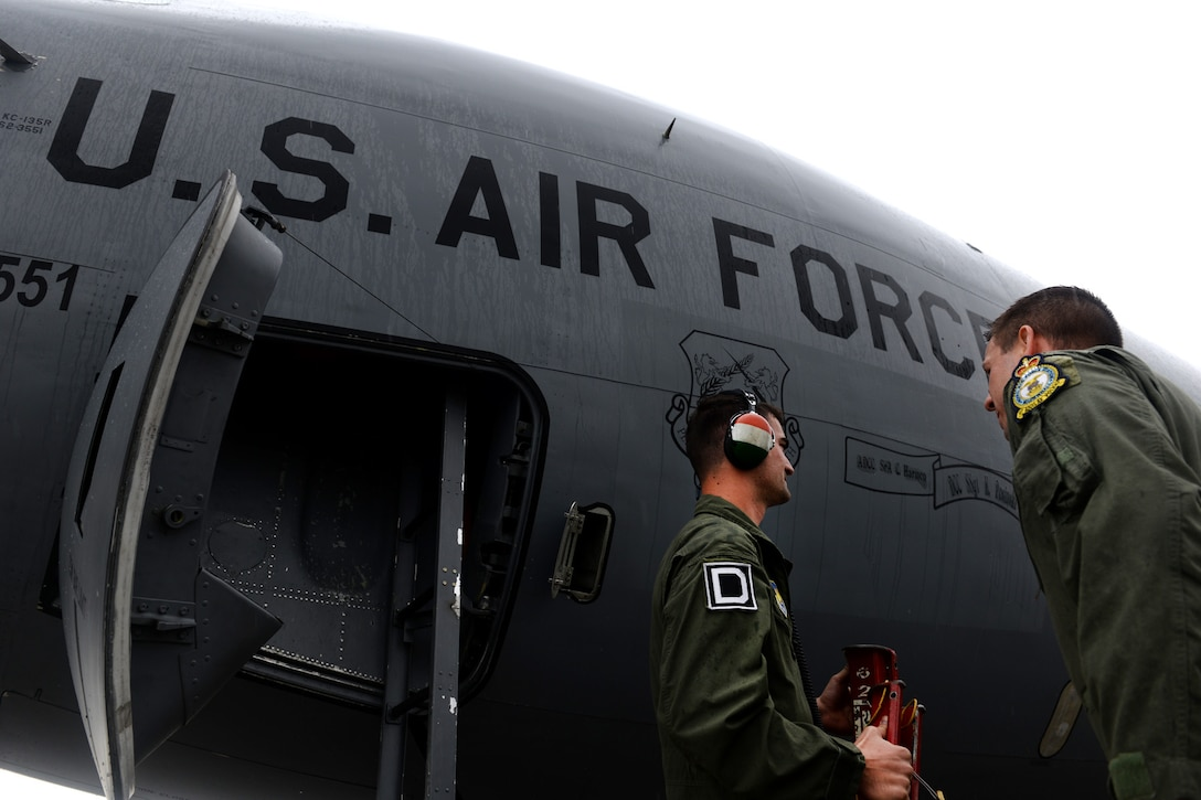 U.S. Air Force Benjamin Kline, right, 100th Air Refueling Wing KC-135 Stratotanker pilot and command post chief from Taylor, Mich., greets U.S. Air Force Senior Airman Justin Estergard, 100th Maintenance Squadron KC-135 Stratotanker crew chief from Callaway, Neb., after landing June 24, 2015, during air refueling familiarization training on Kecskemét air base, Hungary. Hungarian, U.S. and Swedish air force personnel met for a two-week familiarization period enabling the Hungarian JAS-39 Gripen pilots to successfully perform air refueling for the first time. (U.S. Air Force photo by Senior Airman Kate Thornton/Released)