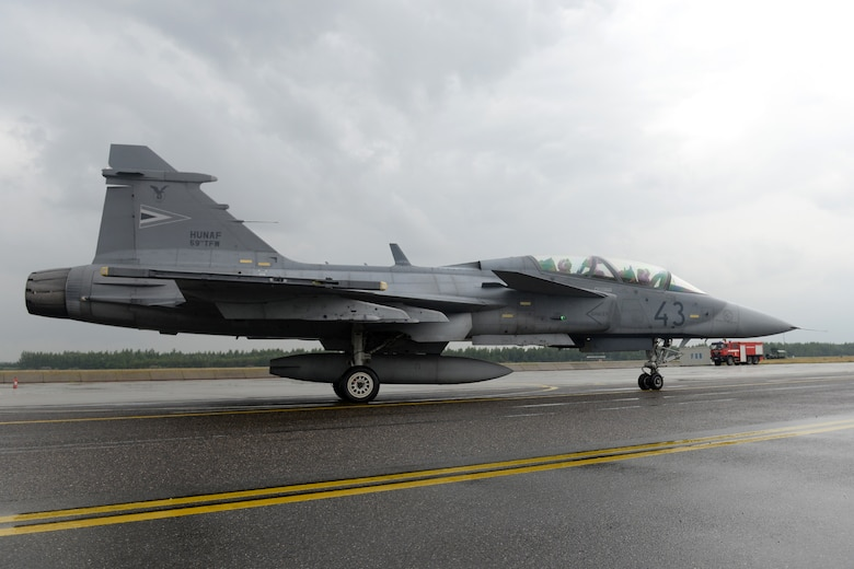 A Hungarian air force JAS-39 Gripen taxis for take-off June 24, 2015, during air refueling familiarization training on Kecskemét air base, Hungary. Hungarian, U.S. and Swedish air force personnel met for a two-week familiarization period enabling the Hungarian JAS-39 Gripen pilots to successfully perform air refueling for the first time. (U.S. Air Force photo by Senior Airman Kate Thornton/Released)
