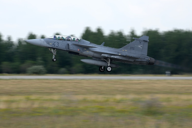 A JAS-39 Gripen takes off June 24, 2015, during air refueling familiarization training on Kecskemét air base, Hungary. Hungarian, U.S. and Swedish air force personnel met for a two-week familiarization period enabling the Hungarian JAS-39 Gripen pilots to successfully perform air refueling for the first time. (U.S. Air Force photo by Senior Airman Kate Thornton/Released)