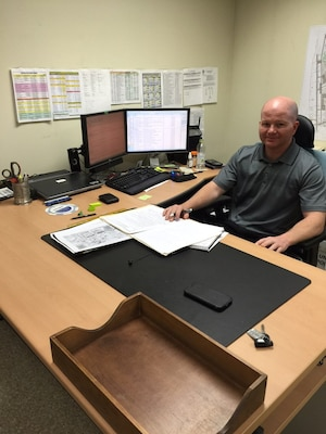 Chris Martin, new resident engineer at the Kunsan resident office, at his desk on Kunsan Air Base.