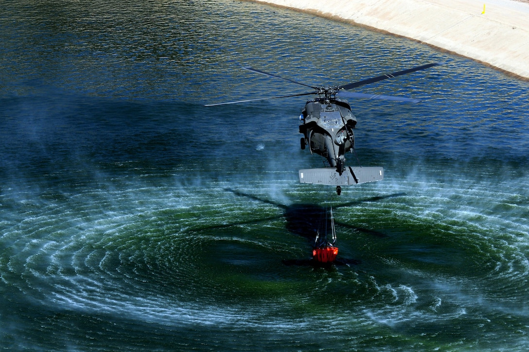 U.S. Army Reserve Soldiers of A Company, 2-238th Aviation Regiment, 11th Aviation Command, conduct water bucket training from a UH-60L Black Hawk helicopter in Hemet, Calif., Feb. 10, 2015. This training was conducted to give the unit the ability to provide Cal Fire support in fighting California wildfires. Training included: Water bucket training using Bambi Bucket's equipped with Torrentula valves, water drops, flight operations, sand tables, fire shelters and classroom training. (U.S. Army photo by Spc. Heather Doppke/released)