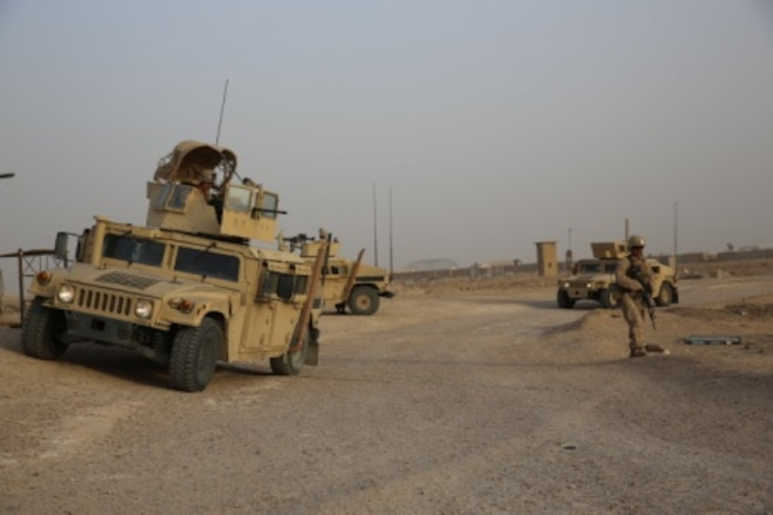 U.S. Marines come to a security halt during a patrol at Al Taqaddum Air Base, Iraq, July 3, 2015. The Task Force Al Taqaddum Security Force runs regular mounted and dismounted patrols of the area to ensure the safety of the Al Taqaddum personnel. Task Force Al Taqaddum is part of Operation Inherent Resolve's Advise & Assist mission, which places U.S. coalition members in mentorship positions with Iraqi Security Force leadership in subjects like logistics and operations planning. (U.S. Marine Corps photo by Cpl. John Baker)