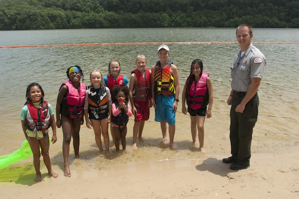 Park Ranger Phillip Sliger poses with a group of kids wearing their life jackets at Defeated Creek Park Day Use Area at Cordell Hull Lake July 9, 2015.  They all received vouchers good for a free ice cream treat or smoothie courtesy of the McDonalds in Gordonsville, Tenn.