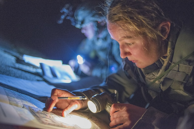 Army Sgt. Jessica Williams, a human resources specialist with the 646th Regional Support Group from Madison, Wis., plots points on a topographic map during the night land navigation portion of the Best Warrior Competition at Fort Devens, Mass. Williams, a native of Madison, is competing in her second Best Warrior competition.  (U.S. Army photo by Sgt. Ferdinand Thomas II, RELEASED)