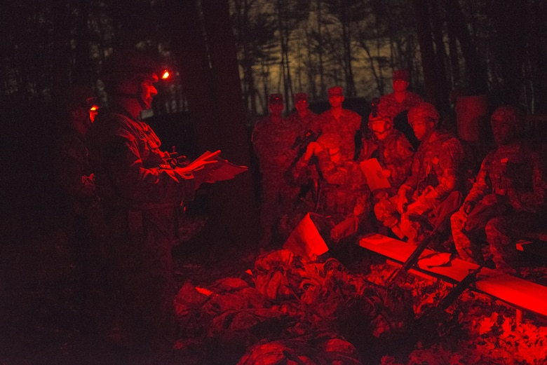 Sgt. 1st Class David Nelson, 220th Transportation Company platoon sergeant in Keene, N.H., briefs all competitors on the rules of the night land navigation course during the 377th Theater Sustainment Command Best Warrior Competition at Fort Devens, Mass. (U.S. Army photo by Sgt. Ferdinand Thomas II, RELEASED)