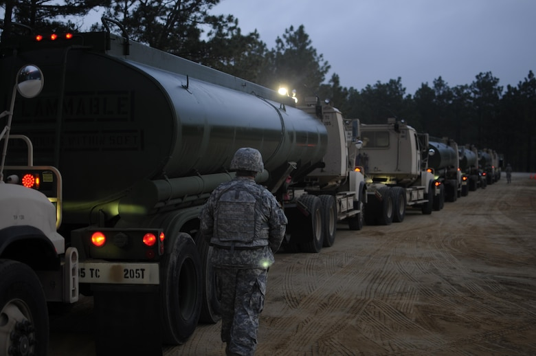Staff Sgt. James Hardin, a motor transport operator with the 705th Transportation Company, inspects vehicle placards prior to the departure of a petroleum supply convoy during the Quartermaster Liquid Logistics Exercise (QLLEX) at Fort Bragg, N.C., June 12, 2015. QLLEX is an exercise allowing Army Reserve units to train delivering fuel and water at the tactical, operational and strategic levels. (Sgt. Christopher Bigelow / Released)