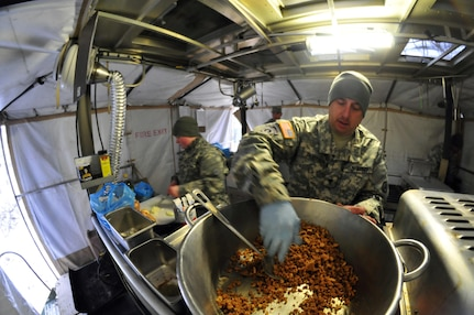 Spc. Jason Sweitzer, from Northern, Pa., a food service specialist with the 254th Quartermaster Company (Laundry & Bath), prepares meatballs during a Phillip A. Connelly Award Competition at Fort Indiantown Gap, Pa., Feb. 7, 2015. The Connelly award was established in 1968 and is designed to encourage professionalism in Army food service teams and recognize excellent performance. (Army Photo by Sgt. Christopher Bigelow / 316th ESC)
