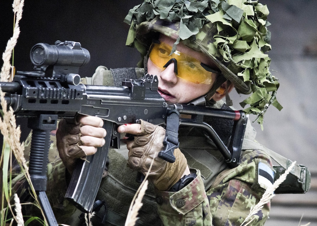 An Estonian Defense Forces soldier from Company C, Single Scouts Infantry Battalion aims his Galil rifle at Estonian army soldiers role-playing as insurgents Sep. 4 at Murru Vangra, an abandoned prison in Rummu, Estonia. The Estonian Scouts Battalion rehearsed with American paratroopers from the 173rd Airborne Brigade in preparation for a night raid training mission at the prison. The raid was part of Steadfast Javelin II, a NATO exercise involving more than 2,000 troops from nine nations conducting various training missions across Estonia, Germany, Latvia, Lithuania and Poland.