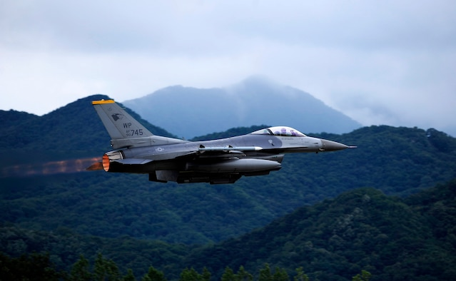 An F-16 Fighting Falcon from the 80th Fighter Squadron at Kunsan Air Base, South Korea, takes off at Jungwon AB, South Korea, during Buddy Wing 15-6, July 8, 2015. Buddy Wing exercises are conducted multiple times throughout the year to sharpen interoperability between U.S. and South Korean forces so, if the need arises, they are always ready to fight as a combined force. (U.S. Air Force photo/Staff Sgt. Nick Wilson)