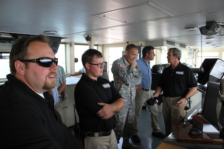 Col. William H. Graham, commander of the U.S. Army Corps of Engineers' North Atlantic Division speaks with the officers and crew aboard the McFarland, a deep draft hopper dredge owned and operated by the USACE Philadelphia District, during a tour on June 30, 2015.