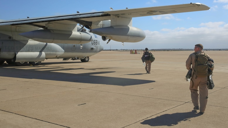 Marines with Marine Aerial Refueler Transport Squadron (VMGR) 352 walk to a KC-130J Super Hercules in preparation for a parachute drop at Marine Corps Air Station Miramar, California, July 8. Marines with VMGR-352 supported 1st Radio Battalion, I Marine Expeditionary Force.
