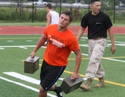 Sgt. Noe Murillo, canvassing recruiter with Recruiting Substation Jersey City, screams at a fireteam conducting the leadership endurance course during a leadership seminar with the North Arlington High School football team, July 14, 2015.