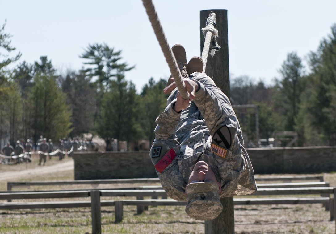 U.S. Army Reserve Cpl. Troy McFall, with the 412th Theater Engineer Command (TEC), and a Pisgah, Ala., native, pulls himself along a horizontal rope April 27. Approximetely 35 U.S. Army Reserve Soldiers with the 412th and 416th TECs are competing for the title of Best Warrior noncommissioned officer and junior enlisted of the 412th and 416th TECs at Fort McCoy, Wis., April 25 to 29. (U.S. Army photo by Staff Sgt. Debralee Best)
