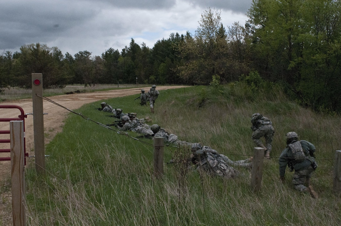 U.S. Army Reserve Soldiers with the 344th Engineer Company (Sapper), move under contact during a situational training exercise lane after simulating destroying an airfield at Fort McCoy, Wis., May 12. The 344th Eng. Company participated in Warrior Exercise 86 15-02 May 2 to 22. (U.S. Army photo by Staff Sgt. Debralee Best)