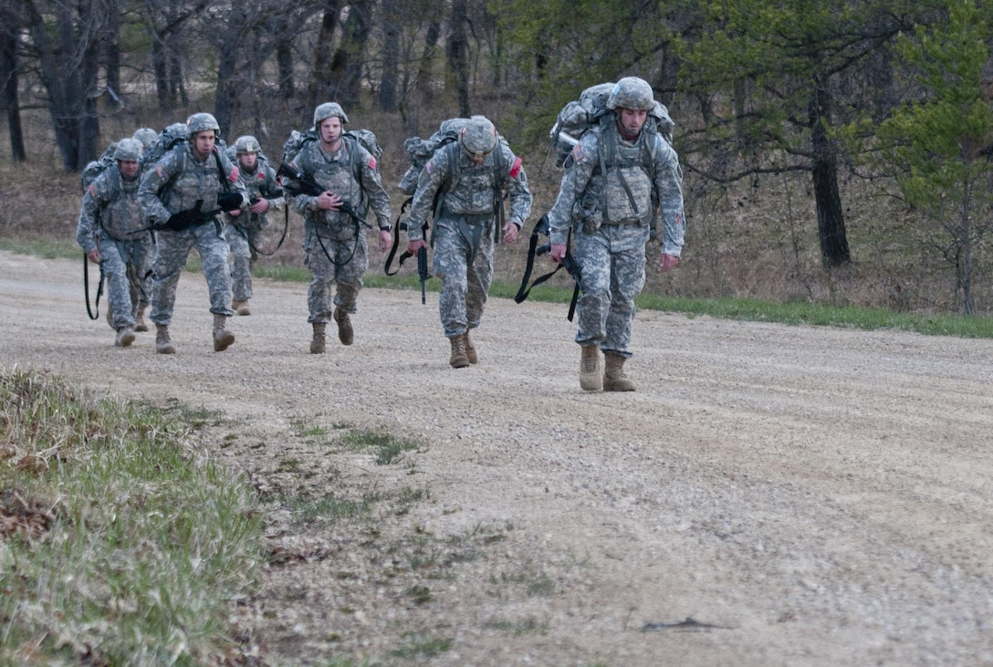 U.S. Army Reserve Soldiers with the 412th and 416th Theater Engineer Commands, ascend a hill during the four-mile ruck march April 28 at Fort McCoy, WIs., while competing to be named the Best Warrior in the 2015 Combined TEC Best Warrior Competition. The 412th and 416th TECs will advance one noncommissioned officer and one junior enlisted Warrior each to the U.S. Army Reserve Best Warrior Competition. (U.S. Army photo by Staff Sgt. Debralee Best)