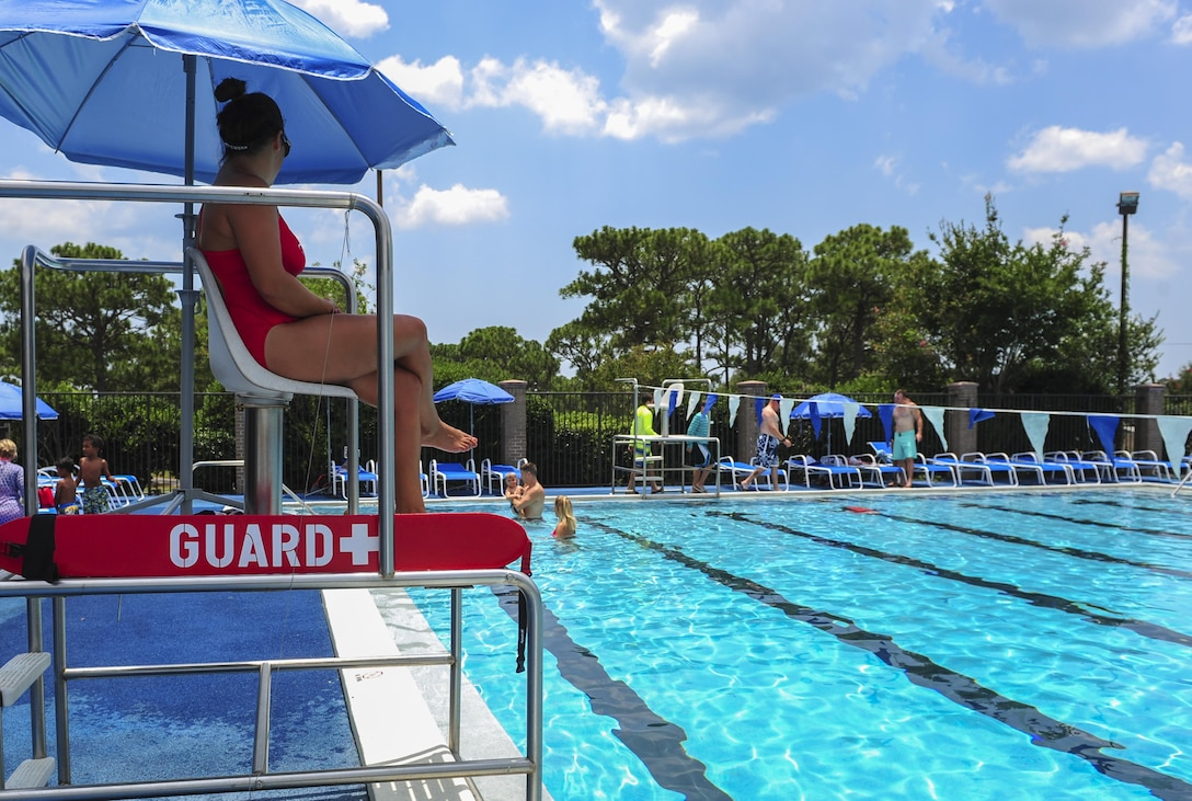 A lifeguard watches over swimmers at the Hurlburt Aquatic Center on Hurlburt Field, Fla., July 12, 2015. The Hurlburt Aquatic Center extended open swim hours to include Sundays from 1-5 p.m.  (U.S. Air Force photo by/Senior Airman Meagan Schutter)