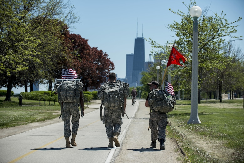 Three Army Reserve Soldiers from the 317th Engineer Company march along the Lakefront Trail, roughly 18 miles into the Chicago Honor the Fallen Ruck March. Approximately 450 military veterans, service members and supporters gathered for a 22-mile ruck march on May 22, just days before Memorial Day, to honor military men and women who suffer from Post-Traumatic Stress Disorder or have committed suicide. (U.S. Army photo by Sgt. 1st Class Michel Sauret)