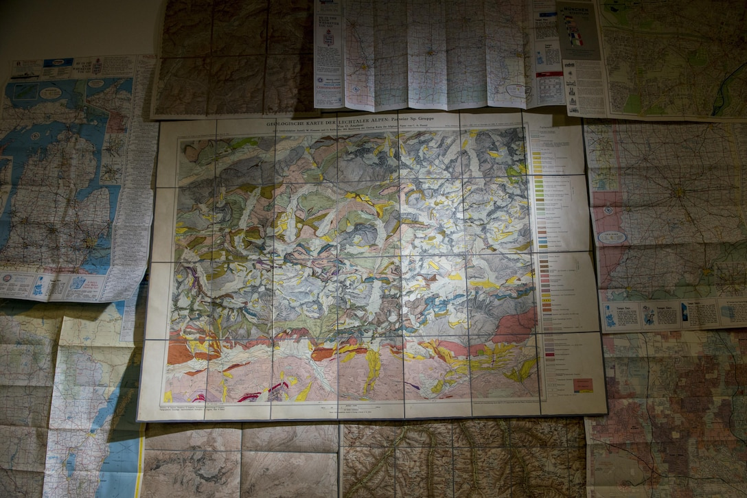 For Master Sgt. Steven Lotz, his fascination for geospatial analysis began with a love for maps, even as a kid. These are some of the maps he collected or inherited over the years, including road maps and mountain climbing maps, such as one of the Lechtal Alps in Germany. He now works for the geospatial cell at the 416th Theater Engineer Command (TEC), as part of the command's redesign process. The geospatial cell is looking for officers, warrant officers and senior noncommissioned officers to bring onto the team. (U.S. Army photo by Master Sgt. Michel Sauret)