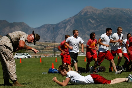 Drill instructors from Marine Corps Recruit Depots San Diego and Parris Island, S.C., and Marines from Marine Corps Recruiting Station Salt Lake City hosted poolees during RS SLC's annual pool function at Camp Williams, Utah, June 26, 2015. During the event, Utah-based recruiters teamed with drill instructors to physically and mentally prepare enlistees for boot camp. The enlistees, part of the Marine Corps delayed entry program, are waiting to ship to boot camp. (U.S. Marine Corps photos by Sgt. Daniel Wetzel)
