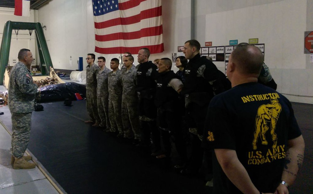 Maj. Gen. John Uberti , U.S. Strategic Command chief of staff, congratulates students on a job well done after successfully completing the Modern Army Combatives Program Level 1 at Offutt Air Force Base, Neb., June 5, 2015. (U.S. Army photo by 1st Lt. Kyle Kennedy)
