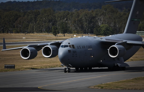 A U.S. Air Force C-17A Globemaster III taxis back to Royal Australian Air Force Base Amberley, Australia, after completing an airborne insertion with the RAAF and U.S. Army to the Shoalwater Bay Training Area, Australia, July 8, 2015. (Royal Australian Air Force photo by Cpl. Shannon McCarthy/Released)