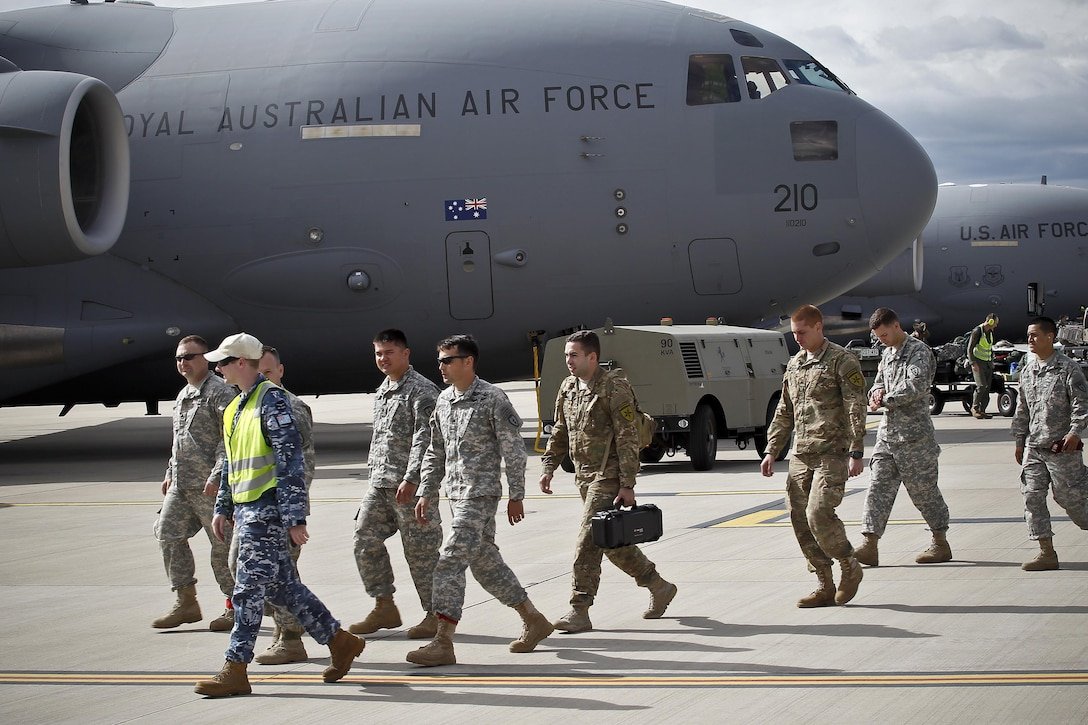 Royal Australian Air Force members accompany U.S. military members off the flight line at RAAF Amberley, Australia, after a personnel drop exercise during Talisman Sabre 2015, July 8, 2015. (Royal Australian Air Force photo by Cpl. Peter Borys/Released)