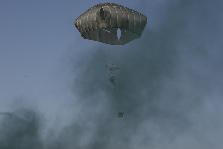A jumper from the U.S. Army 4th Battalion, 25th Infantry Airborne floats down after jumping from a C-17 Globemaster III aircraft during exercise Talisman Sabre in Northern Territory, Australia, July 8, 2015. Exercises such as Talisman Sabre offer a uniquely complex and challenging multinational environment for our forces to hone their skills. (U.S. Air Force photo by Senior Airman Stephen G. Eigel)