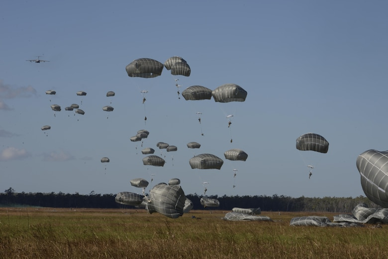 More than 400 U.S. Army 4th Battalion, 25th Infantry Airborne jump from seven C-17 Globemaster III aircraft during exercise Talisman Sabre in Northern Territory, Australia, July 8, 2015. Exercises such as Talisman Sabre offer a uniquely complex and challenging multinational environment for our forces to hone their skills. (U.S. Air Force photo by Senior Airman Stephen G. Eigel)
