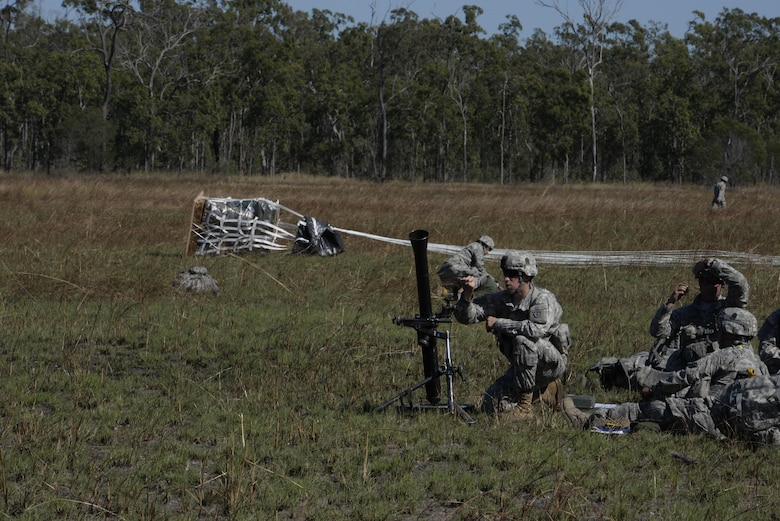 A mortarman from the U.S. Army 4th Battalion, 25th Infantry Airborne, sets up a mortar weapon after jumping from a C-17 Globemaster III aircraft during exercise Talisman Sabre in Northern Territory, Australia, July 8, 2015. Exercises such as Talisman Sabre 2015 provide realistic, relevant training which is necessary to maintain regional security, peace and stability. (U.S. Air Force photo by Senior Airman Stephen G. Eigel)