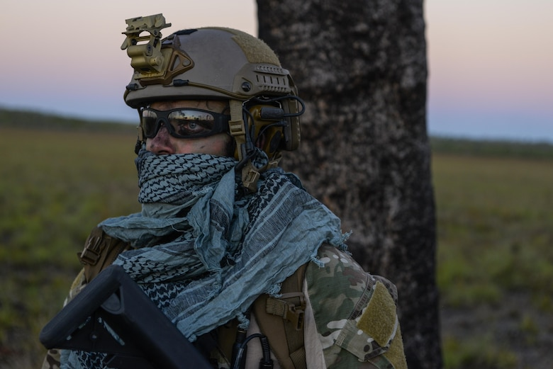 A special tactics combat controller from the 320th Special Tactics Squadron waits for the rest of his team to arrive after performing a high altitude low opening jump during exercise Talisman Sabre in Northern Territory, Australia, July 10, 2015. Credible, ready maritime forces help to preserve peace and prevent conflict. Talisman Sabre participants have the opportunity to further enhance their ability to respond to crises as part of a joint or combined effort. (U.S. Air Force photo by Senior Airman Stephen G. Eigel)