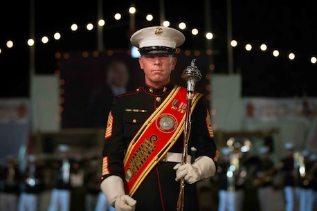 Master Gunnery Sgt. Mark Gleason, bandmaster, U.S. Marine Corps Forces, Pacific Band, marches to his spot during a military tattoo in Nuku'alofa, Tonga July 8, 2015. The MARFORPAC Band travels throughout the Pacific region to promote community relations and interoperability between the U.S. and other countries.