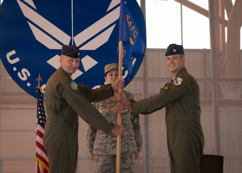 Lt. Col. Andrew Caggiano, 314th Fighter Squadron commander, accepts the 314th FS guidon from Col. Jeffrey Jenssen, 54th Fighter Group commander as part of the 314th FS activation ceremony at Holloman Air Force Base, N.M., on July 14. Caggiano graduated with military distinction from the United States Air Force Academy in 1997. He earned his pilot wings at Euro-NATO Joint Jet pilot Training in 1999 at Sheppard Air Force Base, Texas. He is a command pilot with over 1,850 hours in the F-16 Fighting Falcon. The mission of the 314th FS is to produce the world's greatest F-16 Fighting Falcon pilots and deploy combat mission-ready Airmen to units worldwide. (U.S. Air Force photo by Senior Airman Aaron Montoya)