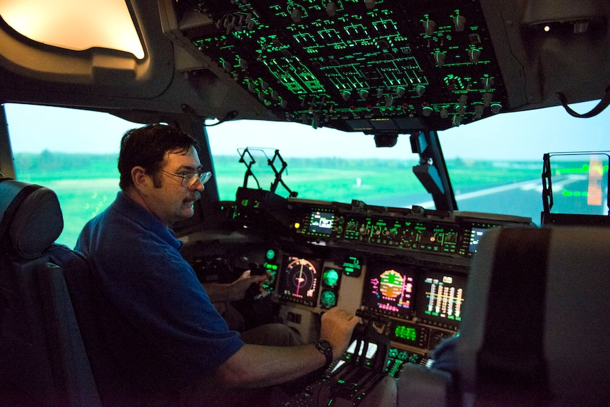 Paul Whidden, a simulator maintenance technician III with True Simulation in Martinsburg, W.Va., takes a ride in the new C-17 simulator at the 167th Airlift Wing, Martinsburg, W.Va. The simulator is used by pilots and loadmasters to practice their skills in a very life-like simulator. The simulator will have the capability in the future to link up with other airframes from other units and go through different flying scenarios. (Air National Guard photo by Staff Sgt. Jodie Witmer/released)