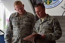 U.S. Air Force Col. Joe McFall, 52nd Fighter Wing commander, and Chief Master Sgt. Brian Gates, 52nd Fighter Wing command chief, discuss their findings during the Dorm of the Quarter competition at Spangdahlem Air Base, Germany, July 8, 2015. The commander and command chief will reveal the final Dorm/Room of the Quarter winners later this month at the Brick House. (U.S. Air Force photo by 2nd Lt Meredith Mulvihill/Released)